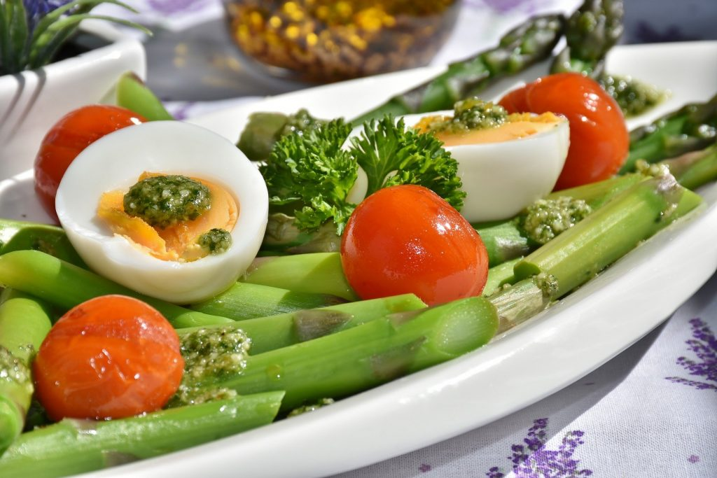 Image of eggs and vegetables - linked to the eye health benefits of egg yolks.